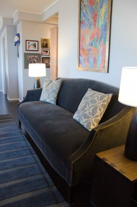 Jayson Home & Garden sofa with Holly Hunt side tables and lighting; existing silk rug