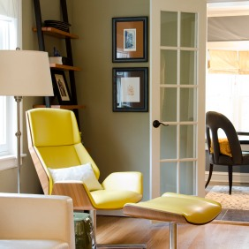 The yellow, leather Kruze lounge chair and ottoman are from Boss Design from the UK.