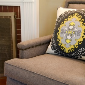 Gray chairs with nailheads were reupholstered in Robert Allen Mateo Felt fabric in Charcoal. Accent pillow is Trina Turk for Schumacher Super Paradise Print fabric.