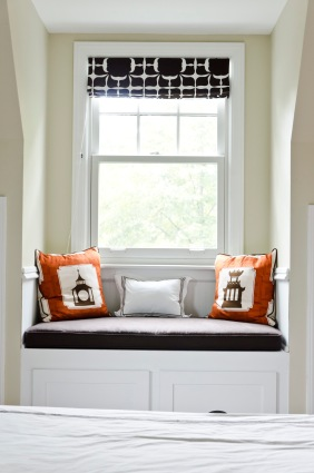 Custom window seat and storage. The window seat cushion is an espresso Robert Allen fabric, and the decorative pillows are a Thomas Paul by Duralee fabric